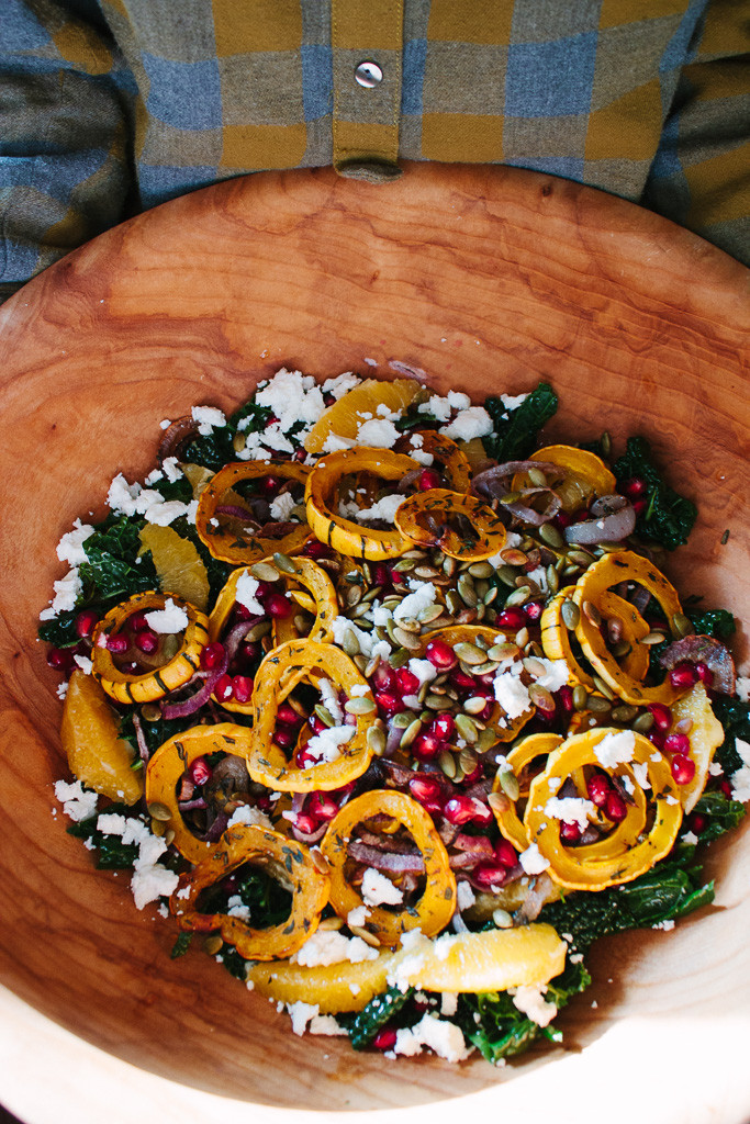 Kale and delicata squash salad with pomegranate, orange & pumpkin seeds